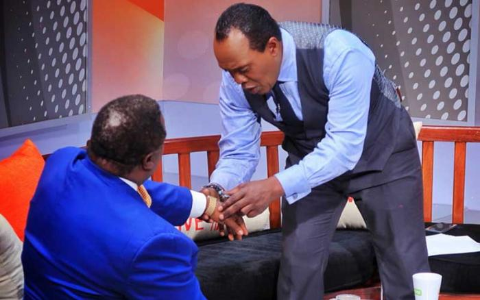 Jeff Koinange (right) admires Cotu Secretary General Francis Atwoli's watch during the JK Live show on Citizen TV on October 23, 2019.
