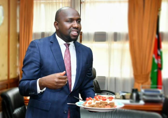 A photo of the Senate Majority Leader Kipchumba Murkomen with a cake in his office.