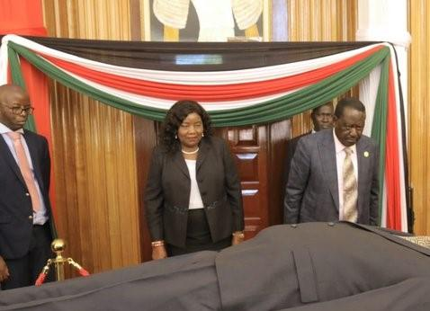 ODM leader Raila Odinga pays his last respects to former President Daniel Arap Moi at Parliament buildings on Monday, February 10