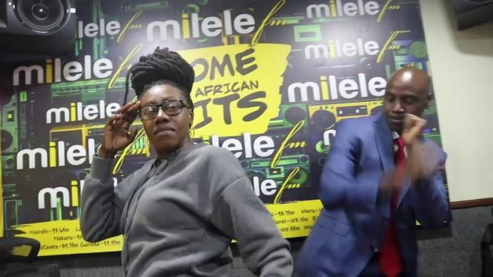 Jacquey Nyaminde popularly known as Wilbroda and Walter Mong'are at the Milele Radio studio.
