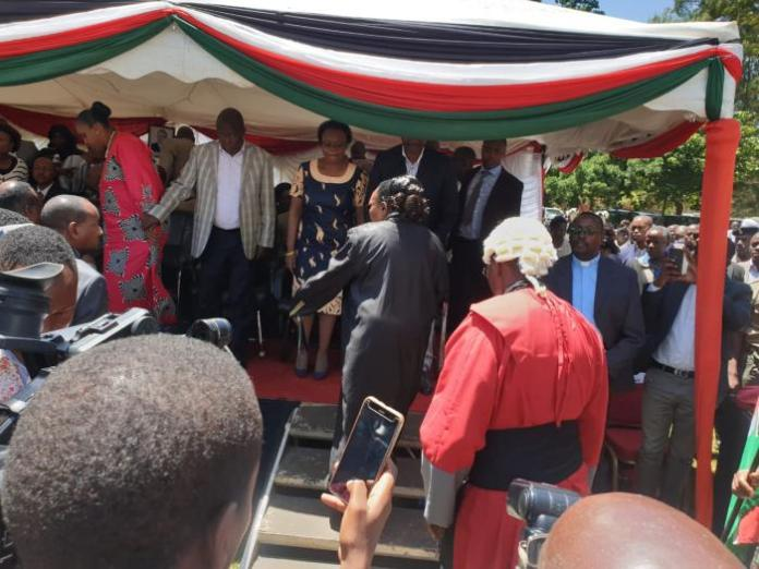 Leaders including Nominated MP Maina Kamanda (in grey suit) on the dais at the swearing in ceremony of Kiambu Governor James Nyoro on Friday, January 31