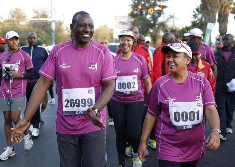 Deputy President William Ruto (left) and First Lady Margaret Kenyatta participate in the Beyond Zero run on March 8, 2015.