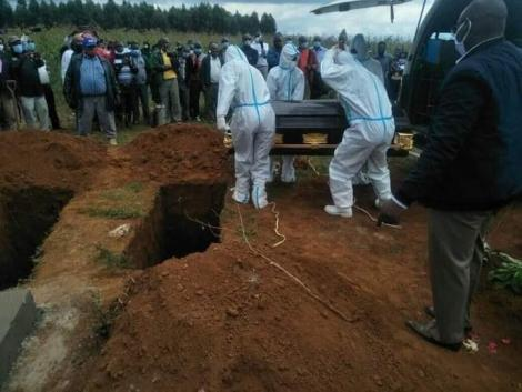 Public health staff in PPEs pictured at a burial in Eldoret, Uasin Gishu County