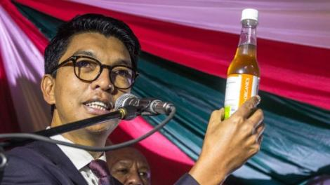 Malagasy President Andry Rajoelina poses with a bottle of Covid Organics on April 22, 2020