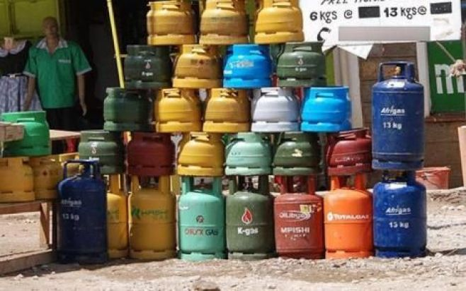 Gas cylinders on display by a roadside.