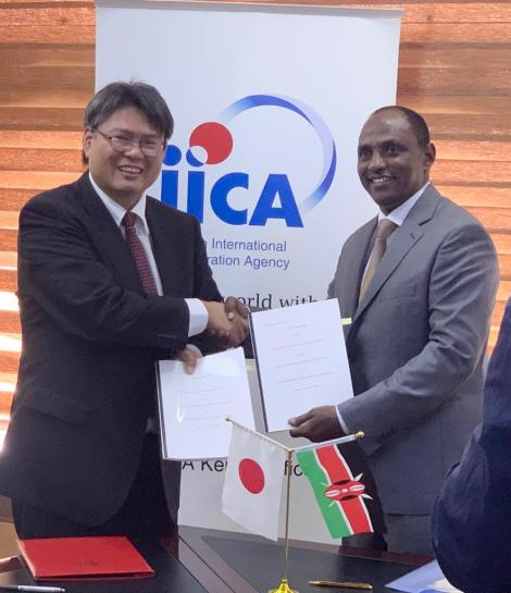 Treasury CS Ukur Yattani (right) with a representative of the Japanese government pose for a photo after agreeing on a loan deal at the Treasury Buildings on February 27, 2020.