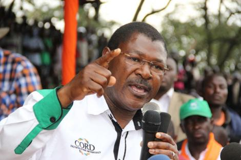 Photo of Bungoma Senator Moses Wetangula gesturing while addressing a political rally in 2013