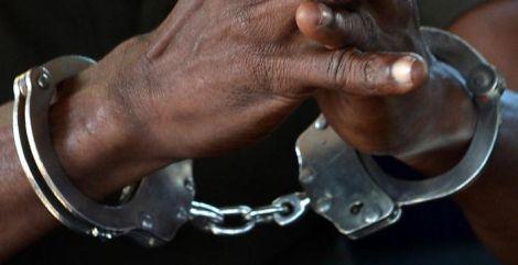 A suspect in handcuffs