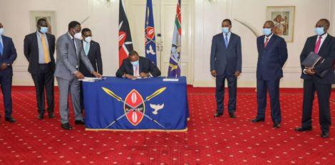 President Uhuru Kenyatta signingthe CRA Bill at State House on October 8, 2020.