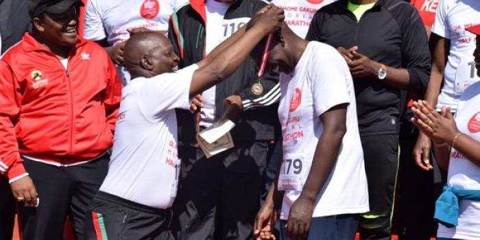 Image result for DP Ruto wins 'gold' in half-marathon