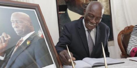 Uasin Gishu politician Jackson Kibor signs a condolence book at the late Mzee Daniel arap Moi's Kabarak house in February 2020