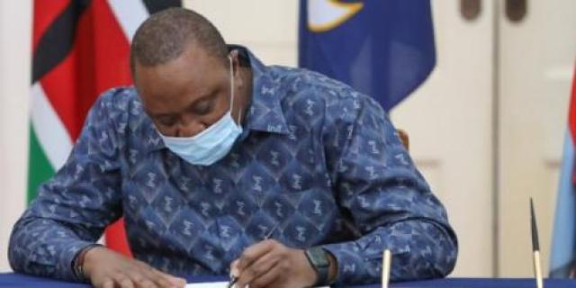 President Uhuru Kenyatta signs into law the Kenya Institute of Curriculum Development (Amendment) Bill of 2019, on Thursday, May 28, 2020