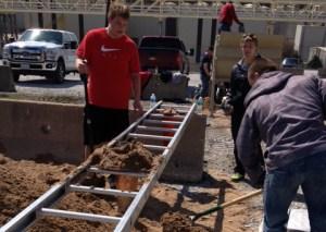 KHS students volunteer to sandbag