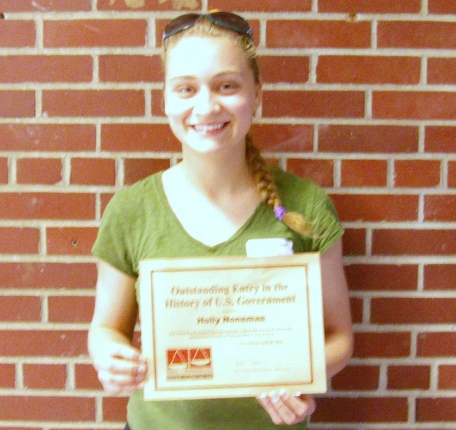"""Congratulations to Holly Noneman for receiving outstanding recognition for her individual exhibit at the National History Day competition. Holly received recognition for having """"The Outstanding Entry in the History of the United States Government""""  and received a certificate and a $40.00 gift certificate to Barnes and Noble."""