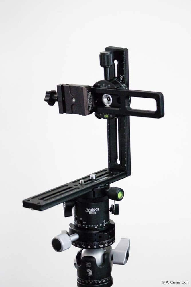 Mount the click-stop rotator on the head then the pano head