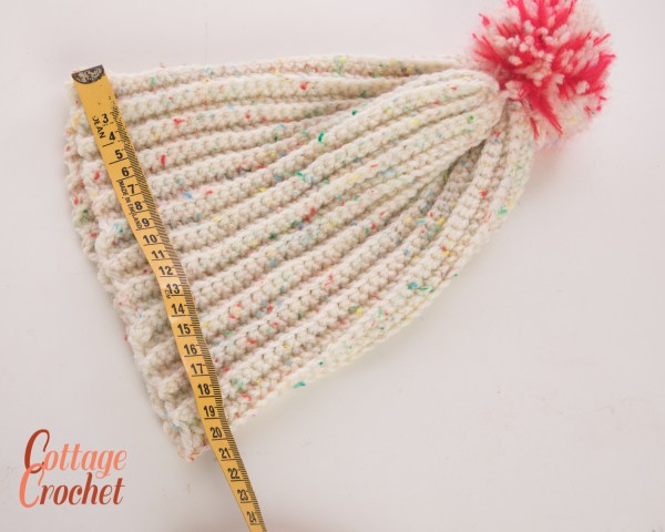 Ladies cream beanie hat with red and white pompom