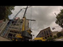 Maxim Grove GMK 6450 erects a tower crane