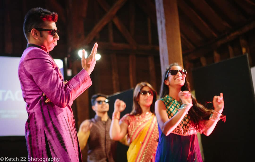 Colourful dancers performing at mehendi and sangeet evening