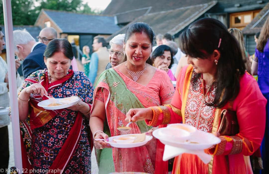 Wedding guests enjoying Indian food at Hindu Sangeet evening