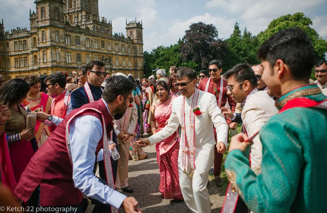 Wedding guests dancing at Hindu wedding