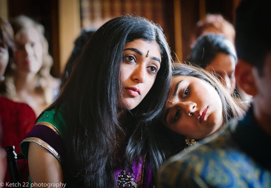 Sisters watching Hindu wedding ceremony