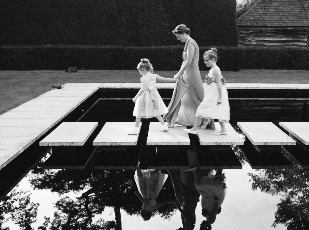 Flower girls on stepping stones at Weddings at Kiftsgate Court Gardens