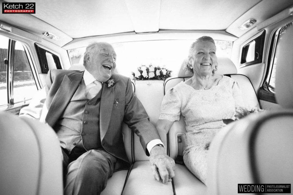 Award winning photo WPJA with older couple in wedding car