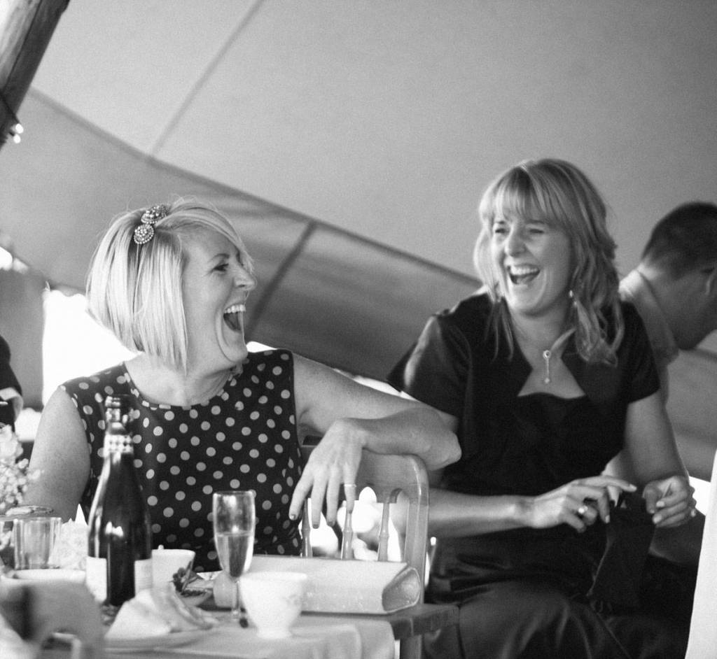 wedding guests laughing at vintage tea party in Shropshire