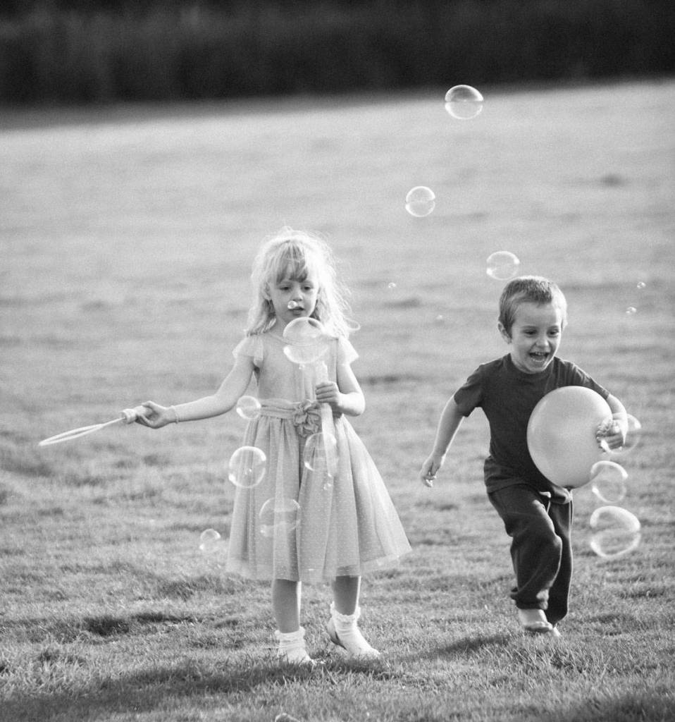 Kids playing with bubbles and balloons at wedding in Shropshire