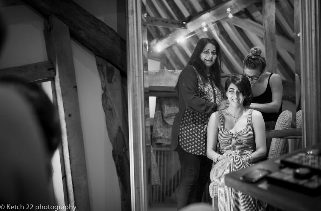 Black and white photo of bride in mirror at wedding preparations in London