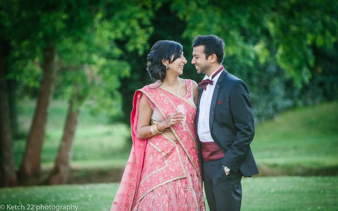 Hindu bride and groom portrait in gardens at Micklefield Hall in London