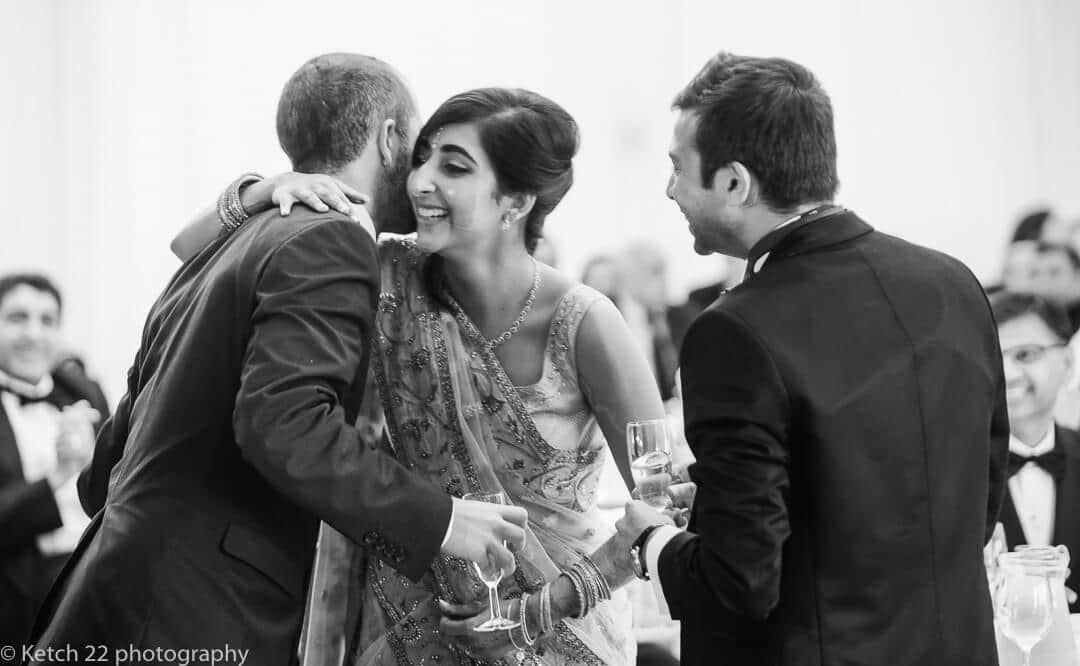 Bride hugging best man after wedding speech
