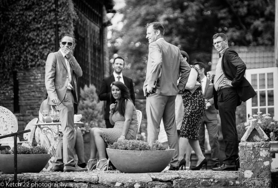 Wedding guests relaxing at How Caple Court