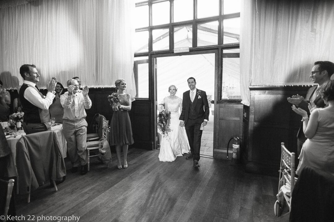 Bride and groom enter dinning room at herefordshire wedding