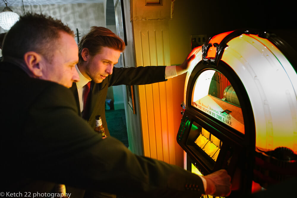 Playing the Juke box at Manor by the lake wedding Cheltenham
