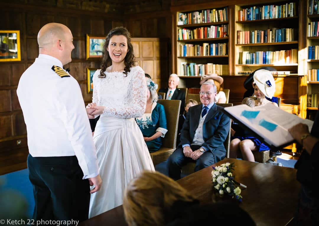 Bride and groom exchanging vows at Country house wedding