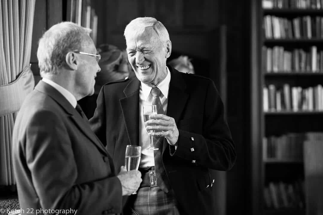 Wedding guests chatting at reception