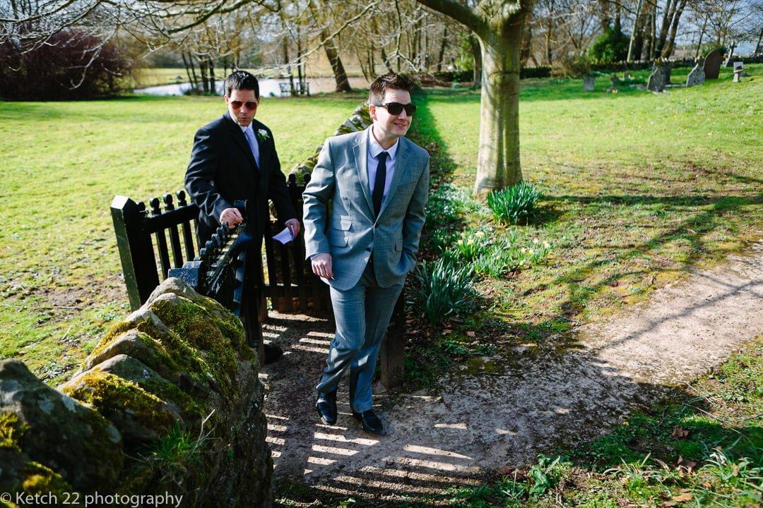 Wedding guests walking through church gate