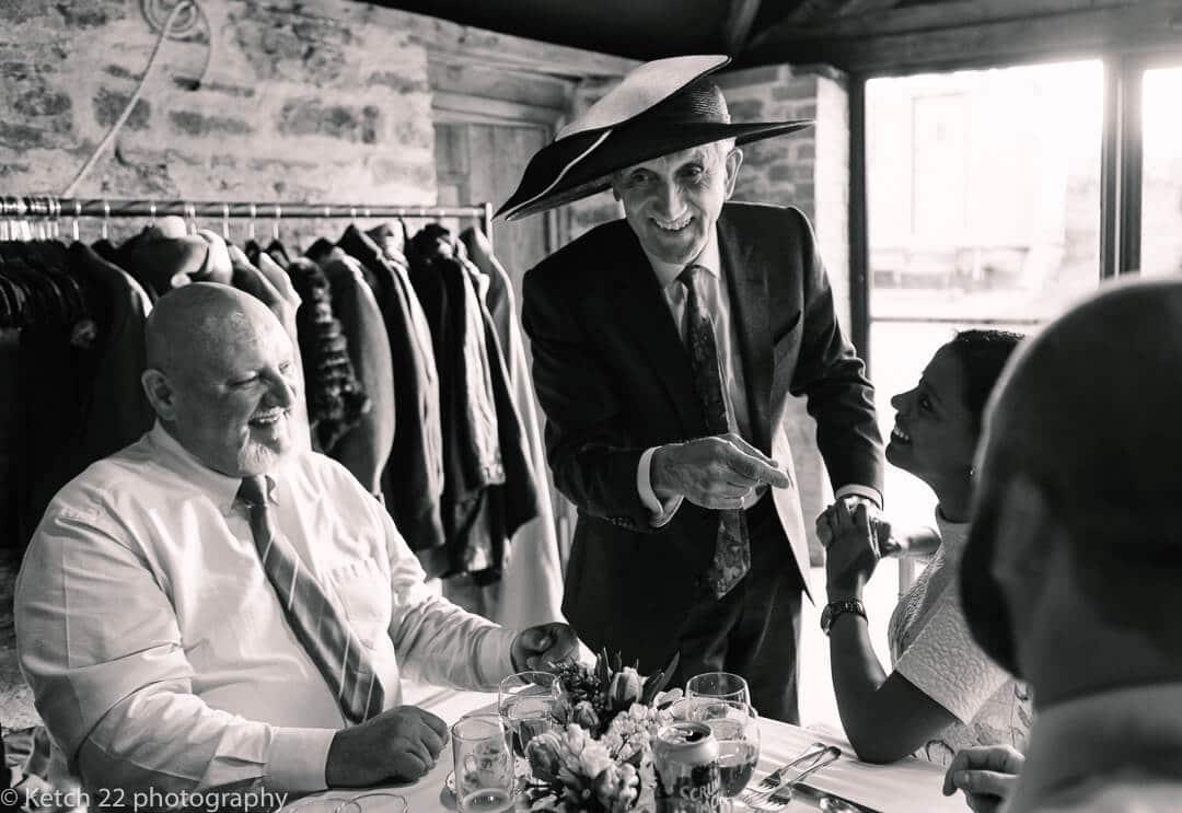 Grandad wearing silly hat at wedding
