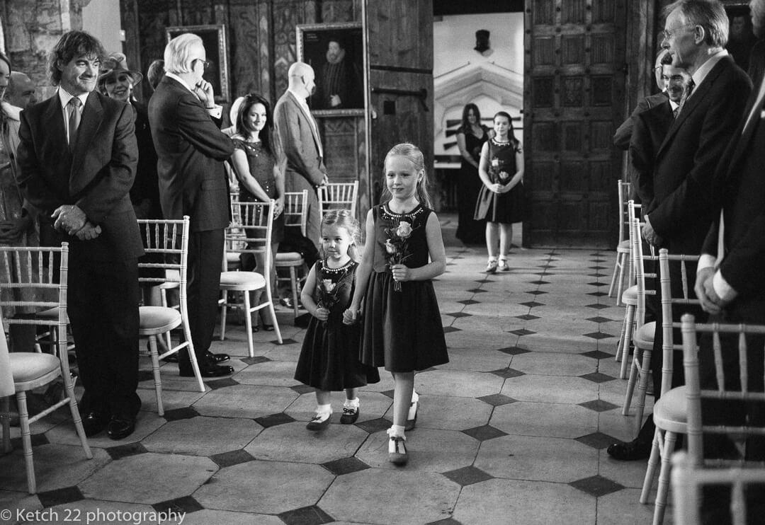 Flower girls enter wedding ceremony room