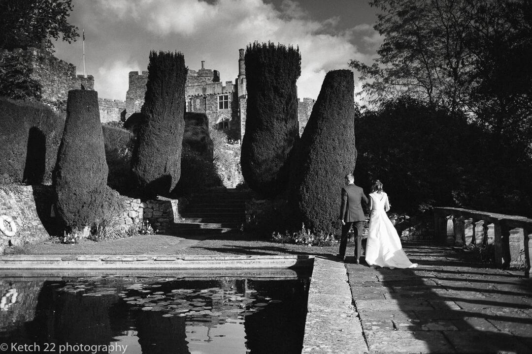 Bride and groom wandering in the gardens at Berkeley Castle wedding
