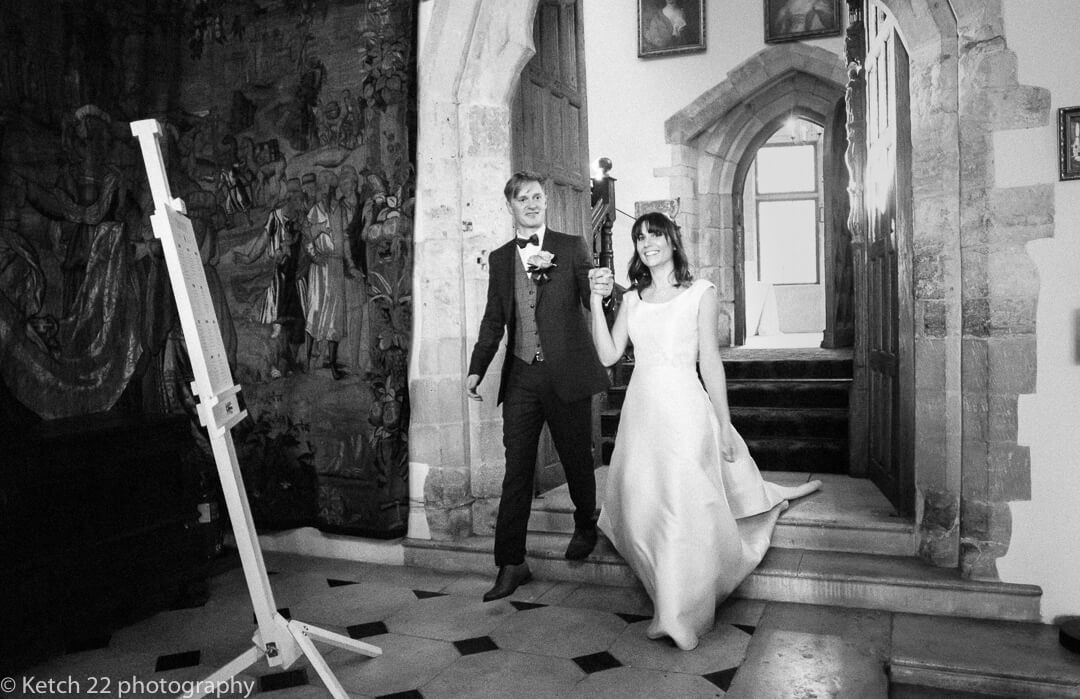 Bride and groom enter dinning room at Castle winter wedding