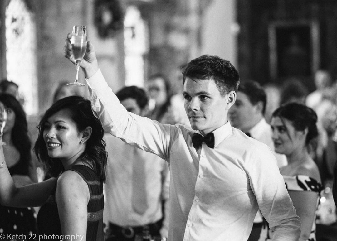 Wedding guest toasting at speeches
