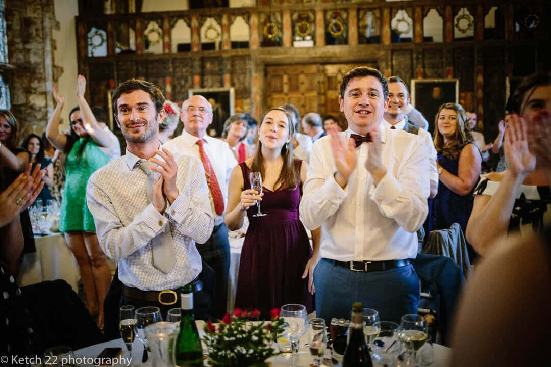 Wedding guest clapping at wedding speeches