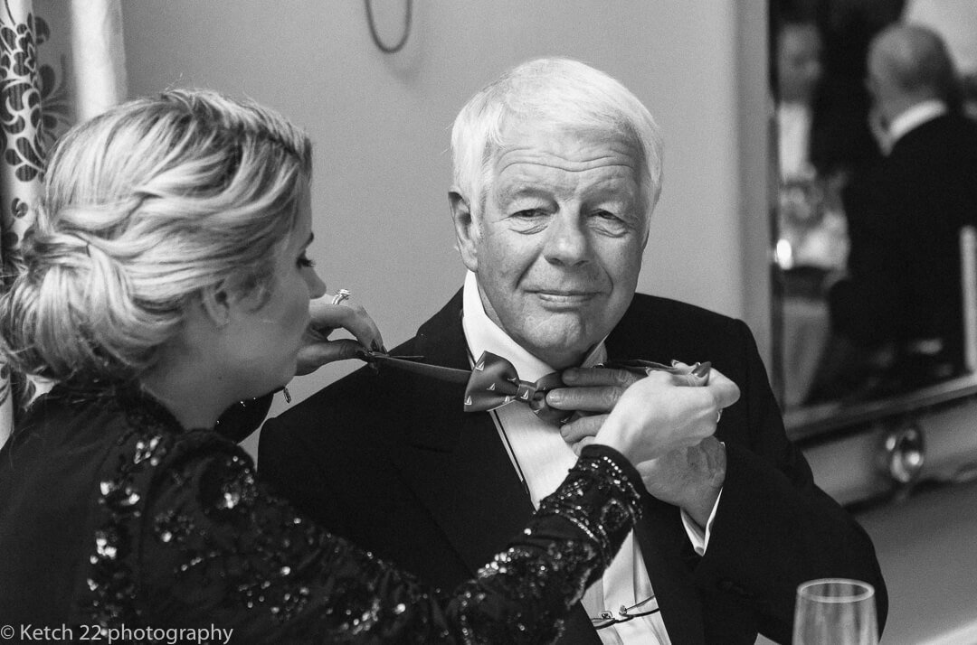 Grandad having his bow tie adjusted at Cotswold wedding