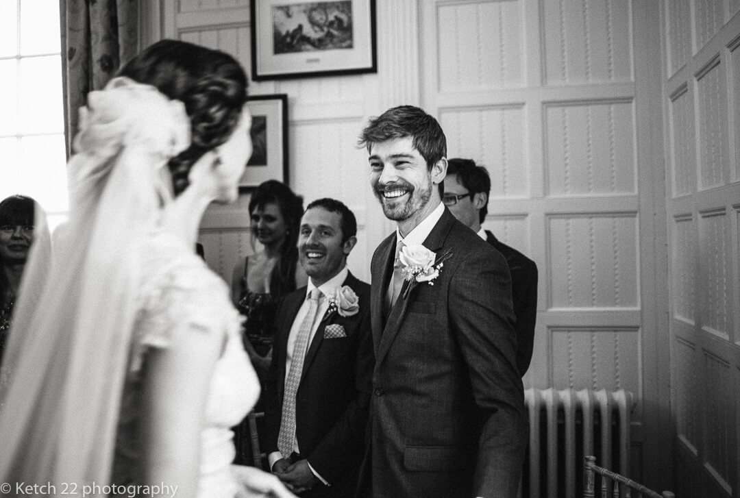 Groom looking at bride for the first time at relaxed wedding ceremony in Herefordshire