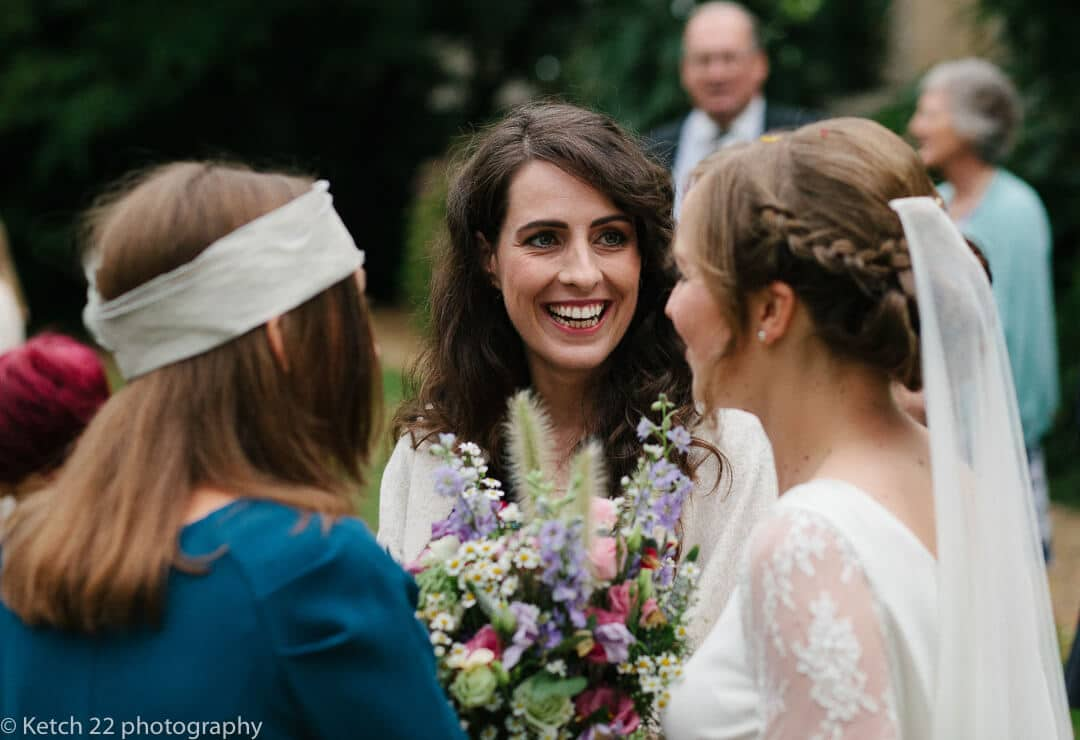 Wedding guests chat to bride