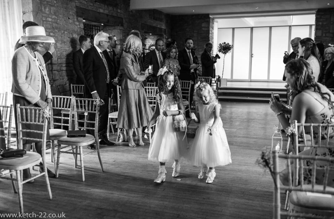 Reportage wedding photo of Flower girls at ceremony