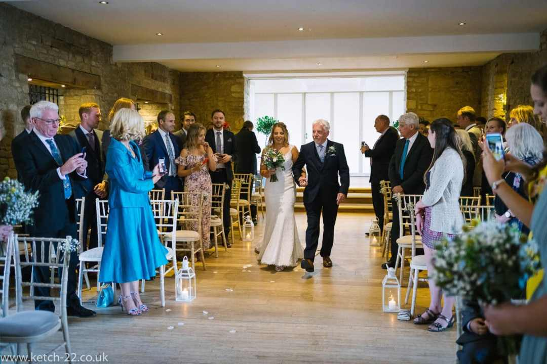 Bride and father enter ceremony for Weddings at The Great Tythe Barn