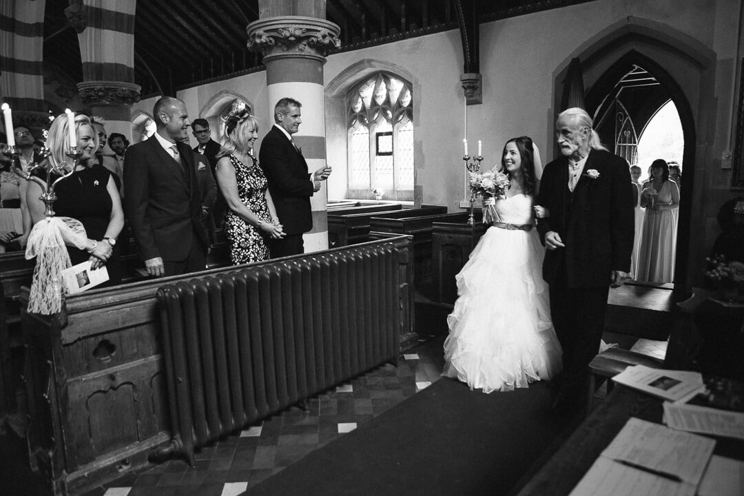 Father and bride enter church just prior to wedding ceremony